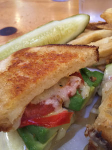 Grilled cheese sandwich with the works.